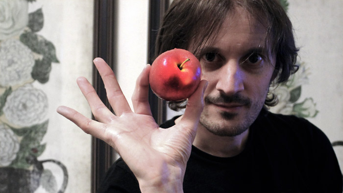 Richard Dutton with a big apple in the Big Apple.